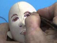 This video demonstrates painting a male face on a cloth doll. It is taken from Mimi's Mannequins, a 2-DVD Dollmaking Workshop.