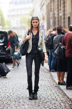 Manon is wearing a jacket from Maje, top from Maje, pants from Maje and boots from Free Lance