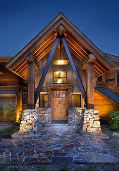 entry, mountain modern, steel knee braces, stone column base, corrugated rusted metal siding, reclaimed wood siding