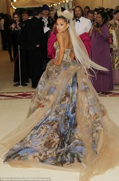Sensational: Ariana Grande's volumunious gown was intricately adorned with the image of Mi... #metgala
