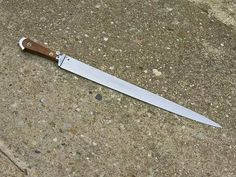 Replica of a Bauernwehr German 15 C.  This long knife is German, late 15 - early 16C. also known as Bauernwehr . It was used as hunting knife or for defense by peasants and/or other non warriors.