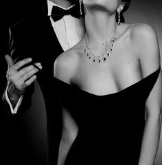 a most beautiful dress.. that you will look most beautiful out of. so he eases the black silk from her shoulders the dress sliding along her contours and falling into a graceful puddle at her...