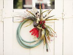 RUBBER HOSE-- Add some flowers and trinkets to make it into a cute outdoor wreath.