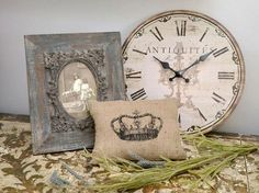 Love this style all round :) And this pic reflects 3 of my favorite things. Clocks, picture frames and scatter cushions.