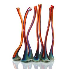 Cherry and turquoise colored hand-blown glassware.