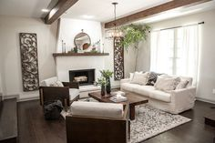 The look of the stucco fireplace combined with the raw wooden beams really highlights the high ceilings and gives the Italian chateau feel the Ignacio family was looking for.