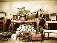 December 1922, Tutankhamun's Tomb | Objects, including the cow-headed couch (Carter no. 73) and boxes containing joints of meat (Carter nos. 62a to 62vv) piled up against the west wall of the Antechamber.