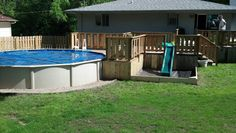 Almost complete 21' Above ground Pool with deck, land scaping and slide into sand box