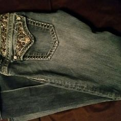 Miss me's Preloved miss me's. Still in great condition. Only missing embellishments on label as shown in the last picture. Size 29 inseam 31. Black embellishments and studs and diamonds on back pocket. Pictures do not do them justice! Miss Me Jeans Boot Cut