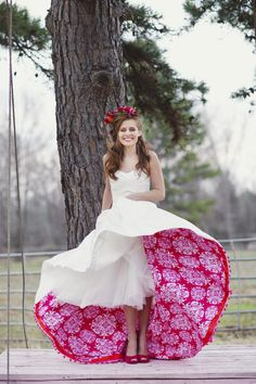 Underside of gown an unexpected pop of color | Romantic Bride Poses on Swing Shows Off Pink Petticoat  So cute! I would want something like this with like a silk black ribbon around the waist or something lol