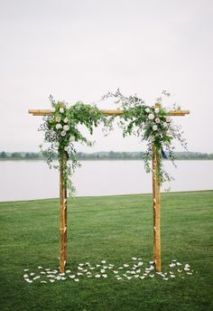 Light wood, pink and white florals, romantic arbor // Riverland Studios