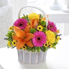 Nothing shows the summer more than this vibrant basket arrangement perfect for any wedding.