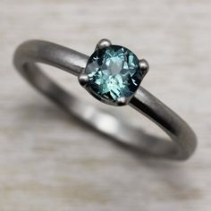 Our 5mm Crown Solitaire Engagement Ring with an aqua blue sapphire, in 950 palladium.