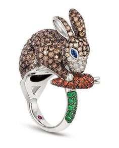 Rabbit ring in 18kt white gold with brown and colorless diamonds, blue and orange sapphires and natural green garnet. #showmeyourrings #jewelrystateofmind #lovegold #luxury #luxurybyjck #jewelry #jewelrydesign #jewels #diamond #diamonds #custom #love #stunning #beautiful #color #finejewelry #highendjewels #ringoftheday #gemstones #blingbling #wow #diamondjewelry #instajewels #diamondsareagirlsbestfriends #wishlist #sparkle