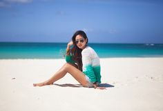 I love how the sweater matches the turquoise water!