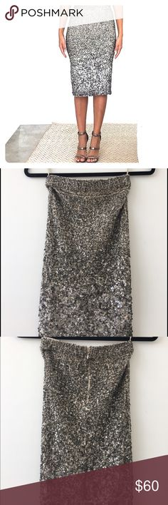 All Saints Sequin Skirt Authentic All Saints sequin skirt. Skirt has stretch.  Silver/Pewter sequins. Pencil skirt silhouette. Worn twice and like new. There are is a small patch of sequins missing so lowering price to reflect that. All Saints Skirts Pencil