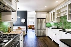 white cabinets and dark floors