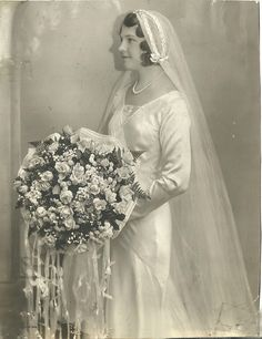 Circa 1920s-1930s bride with a large bouquet!