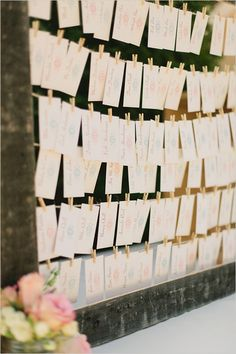 DIY escort card ideas. The bride took a vintage photo frame, strung twine in rows and hung the escort cards using mini clothes pins. Super cute! Photo by Lucid Captures. Wedding Planning by Perfectly Posh Events