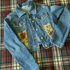 "One of a kind!  Upcycled cropped denim jacket Artfully frayed cropped denim jacket.  Upcycled with floral pattern.  One of a kind!  No size tag - Jacket measurements are shoulder width 19"", shoulder to cuff 24"", collar to hem 16.5"" Jackets & Coats Jean Jackets"