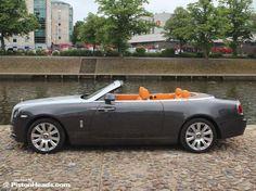 The Rolls-Royce Dawn Drophead Coupe mandarin orange brown black seats console dash interior, grey anthracite and silver exterior color