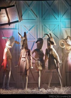 What more could I love about this window? Love the mannequins stances, the dis-proportionate animal heads, the use of coloured lighting, the almost hazy effect with the feathered floor and lack of clear lighting. LOVE.