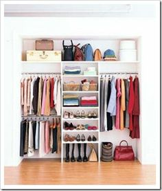 It just occured to me today to use a vertically placed EXPEDIT shelf from IKEA, then place a rod for long clothes on one side, and two (for shirts and pants) on the other half of the closet. Inside the shelves, dividers could be used to make smaller cubbies for shoes, etc.