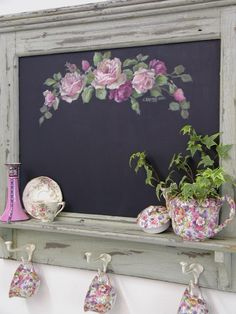 "Pretty chalkboard! Wonder if the hooks are strong enough to take the weight of coats. It could be a dont forget board as you leave the house in the morning....like ""dont forget your lunch"" or ""remember your wallet"""
