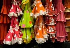 Flamenco dresses hanging in a market in Spain.  We bought Chelsea one when she was only three.  Wow.  Seems like yesterday.