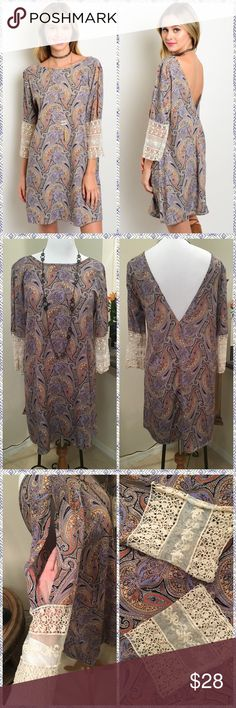 🆕Blue Paisley Dress Absolutely beautiful blue paisley dress with antique crocheted sleeves. Also features slits in sleeves from shoulder to top of crochet on both arms and deep V-neck back line. Very comfortable with a loose fit. 100% Poly💫True to size💫Made in USA🇺🇸✳️PRICE FIRM UNLESS BUNDLED✳️NO TRADES✳️ LDB Dresses