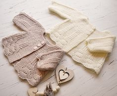 Ravelry: Shell border baby cadigan pattern by OGE Knitwear Designs
