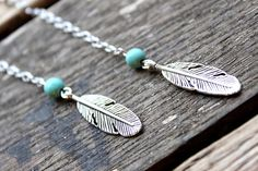 Dangle silver Feather Long earrings with a by handmadebyinali