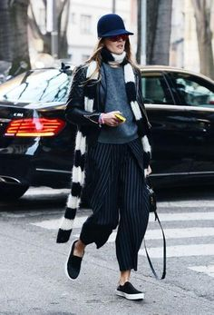 winter outfit inspiration - pin stripe trousers, slip on sneakers, fuzzy black & white scarf, + gray crew neck sweater and baseball cap