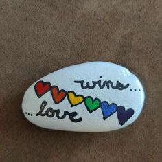 Love wins ❤️🧡💛💚💙💜 $15 + shipping and handling Painted Rocks For Sale, Hand Painted Rocks