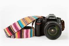 The Spring Break Camera Strap - A colorful cotton camera strap with the comfiest neoprene backing. ($26.00, http://photojojo.com/store)