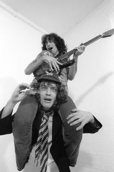 Bon Scott on Angus Young's shoulders!