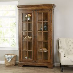 A rich brown finish gives this cabinet a handsome look while 4 adjustable shelves offer ample storage space. Use it in the dining room to display heirloom china or shimmering objets d'art. Living Room Display Cabinet, China Display, Jewelry Cabinet, First Home, Adjustable Shelving, Built Ins, China Cabinet, Storage Spaces, Home