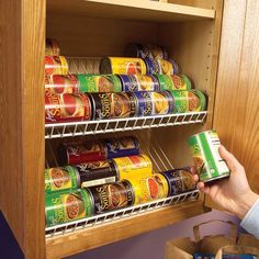 Use closet racks as cabinet organizers. Trim the racks to length with a hacksaw and then mount screws to the back side of the face frame to hold the racks in place. The back side of the rack simply rests against the back of the cabinet. Now you can easily find your soup and check the rest of your inventory at a glance. We are so doing this!