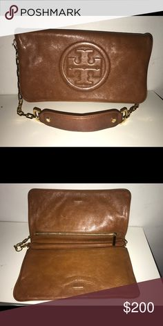 Tory Burch Reva Clutch Gently used authentic Tory Burch calf leather purse with removable strap. Rarely worn. Tory Burch Bags Mini Bags