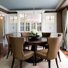 Chocolate Brown Walls with a white trim, a pale blue ceiling and a light area rug - love this palatte!