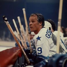 """Gordie Howe onthe Astro's bench during his WHA years. Note the name on the back of the jersey """"GORDIE"""". Nice touch. Howe still looks good. He would play until he was 52"""