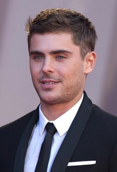 Men's Formal Short Straight Hairstyle This formal short hairstyle from Zac Efron is clipper cut around the back and sides maintaining a neat and tidy look and feel to the edges blending into the top layers that are jagged cut to achieve a textured finish. This short hairstyle for men is great for any occasion[Read the Rest]