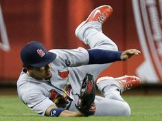 center fielder Jon Jay makes a sliding catch on a line drive hit by Cincinnati Reds' Ryan Ludwick in the fourth inning. Cards lost 9-5. 9-09-14