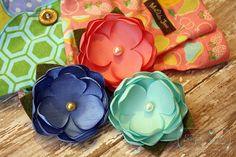These sweet flower hair clips can be worn separately or clustered together. All flowers are handcrafted out of satin fabric and have colorful bead