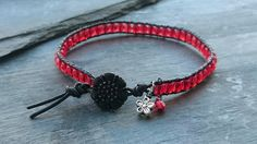 Black leather and red beaded bracelet £10.00