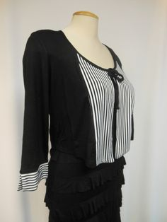 Unique Bolero.... Black with stripes !!! Tie front, 3/4 sleeves.  Great for covering your arms on our fantastic Ruffle Dresses !! 65% Viscose, 30% Polyester,