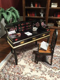 """Dollhouse miniature Carlton Desk & Chair Black W/ Hand Painted Asian Accents -This Carlton desk has a black finish with hand painted Asian accents.  It has working drawers and is in excellent condition.  It measures 3-1/2"""" in height.    I have also included a chair.  I'm not sure if it is an exact match with the accent paint, but it's close enough in my opinion. It measures 3-1/4"""" in height. Z"""