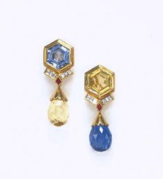 A PAIR OF SAPPHIRE AND DIAMOND EAR PENDANTS  Each suspending a detachable briolette-cut blue or yellow sapphire, with a polished gold cap, to the hexagonal yellow or blue sapphire surmount, with baguette-cut diamond and lozenge-cut ruby accents, mounted in gold