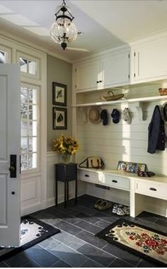 Redesign the back porch when it becomes a sunroom after this mudroom design, complete with those doors leading out to the garden.