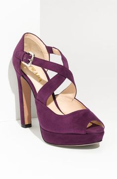 I try to stay away from  purple, and then I run across something like this.  Say it with me now, oooh Prada.
